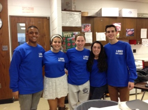 The Peer Leaders are shown wearing their customized shirts.
